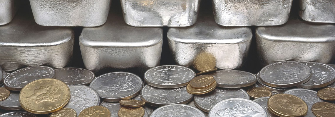 stack of silver bars and gold coins